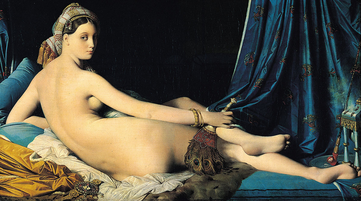 A nude woman, painted from the back. She looks over her shoulder at the viewer of the painting. Only half of her face is illuminated; the other is in shadow. She is lying on a bed with different fabrics covering it. Her hair is covered with a wrap.