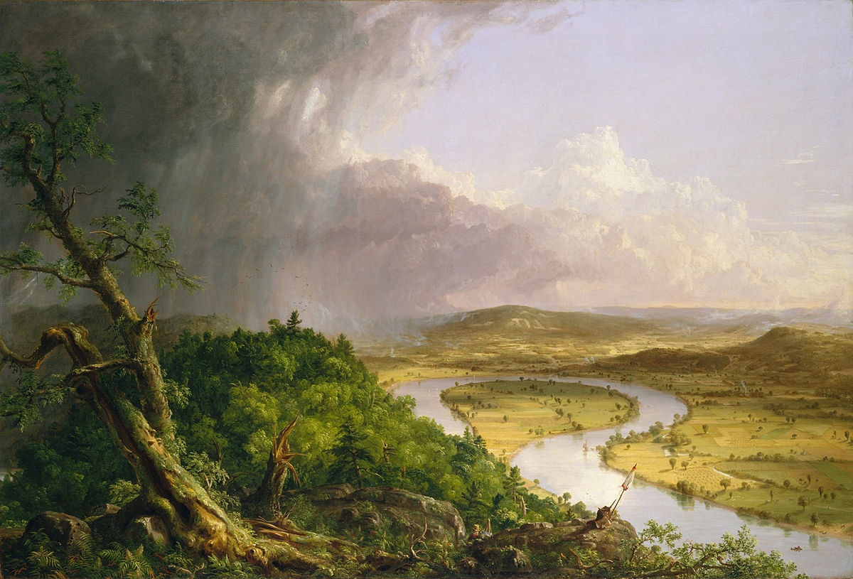 The foreground contains a rich green hill with trees and rain clouds above it. In the background is a green grassy field with a river. The river makes almost a complete circle, but both ends of the river part.