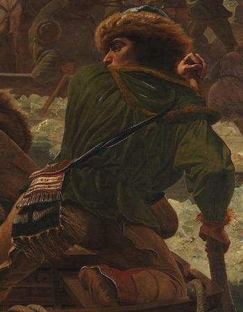 A Native American man navigating the boat