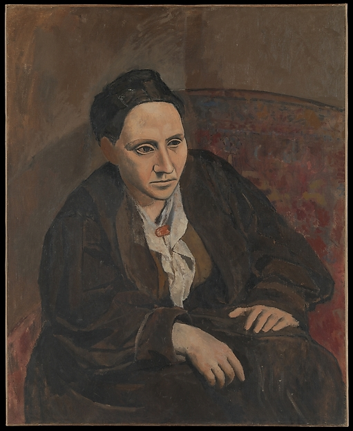 Gertrude Stein leaning forward, with her hands on her knees. She is wearing dark browns. The background of the painting is a brown with hints of a wallpaper pattern.