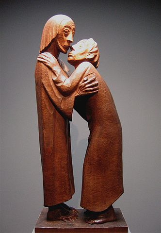 Two figures embracing. One looks to the side, while the other, whose head is positioned lower is looking up at him.