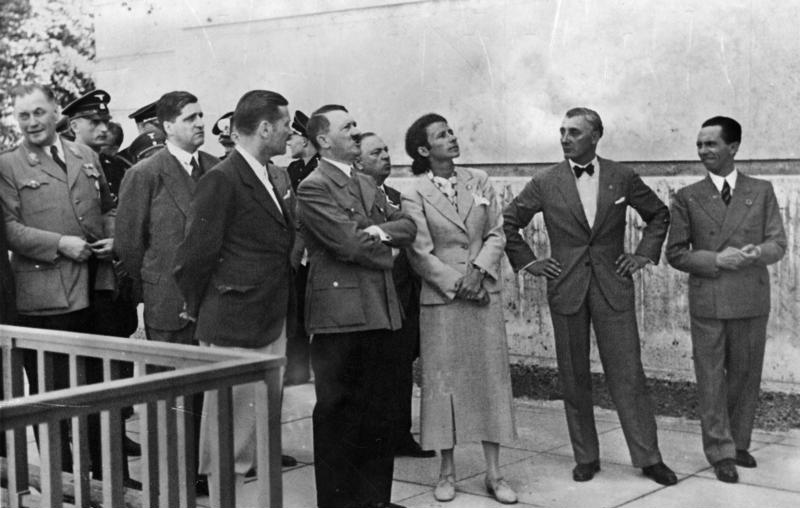 Photograph of Adolf Hitler and several other individuals standing outside the House of German Art.