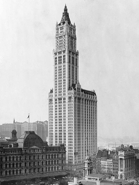 The Woolworth building rises into the sky, easily twice if not three times as high as all of the other buildings around it.