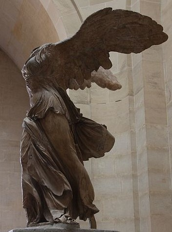 A winged woman. Over time, the head of the sculpture has been lost.