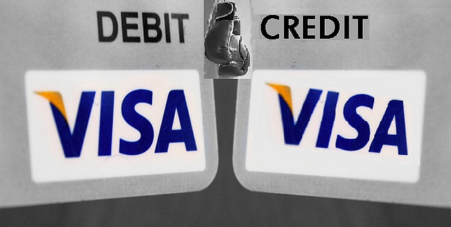 Image showing the corners of two Visa cards---one is a debit card and the other is a credit card.