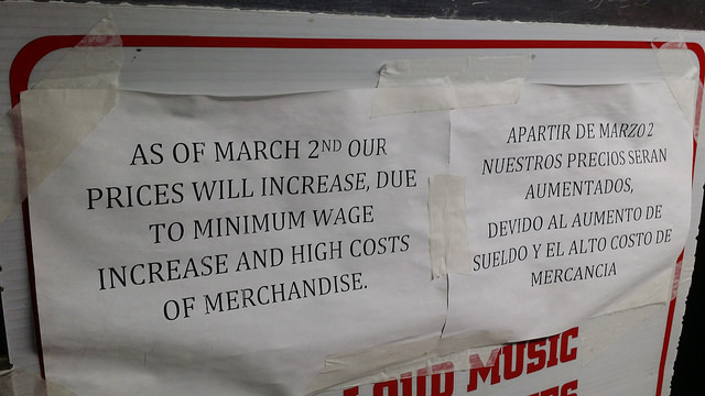 "Sign on a store that reads, ""As of March 2nd our prices will increase, due to minimum wage increase and high costs of merchandise."""