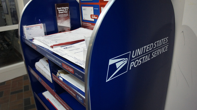 Photograph of envelopes and priority packaging options at the Post Office.