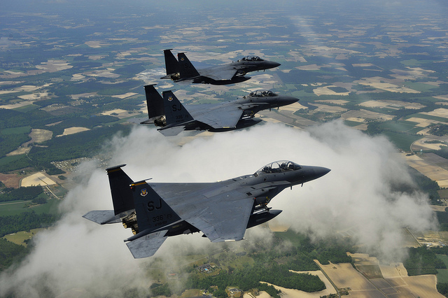 Photograph of three flying F-15 Fighters.