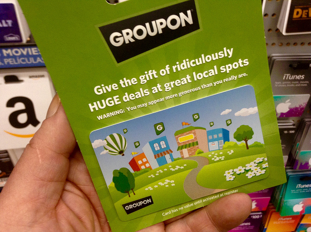 Image showing a Groupon gift card help in someone's hand.