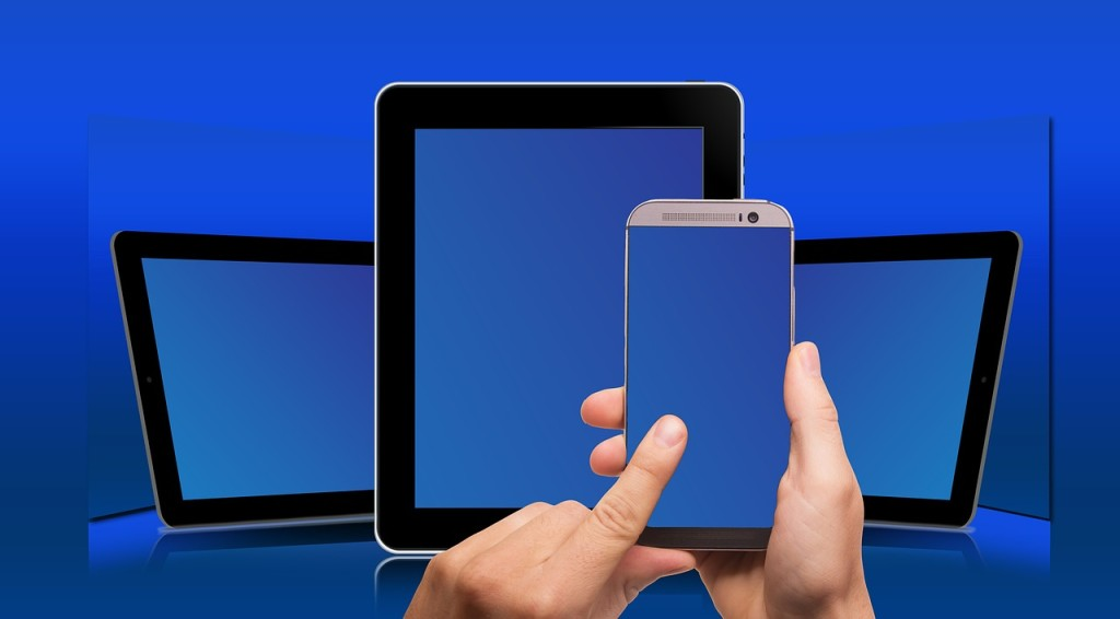 Three different devices with touch screens: large and small tablets and a smart phone.