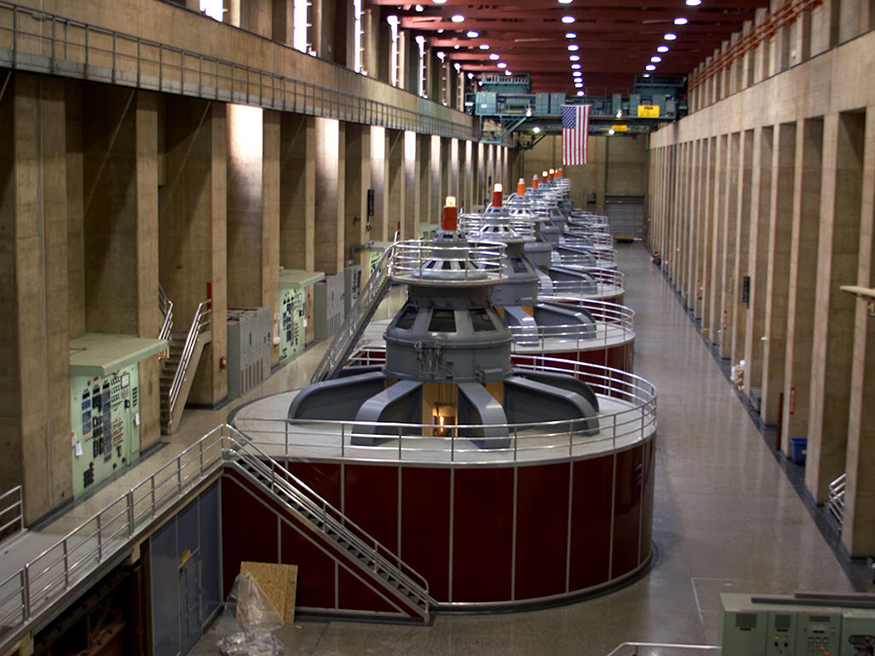 Photo of large circular generators inside a large hallway.