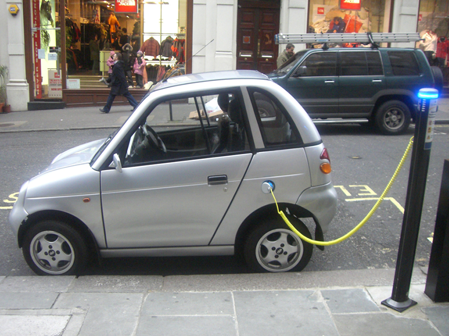 Photo of car plugged into a charging station.