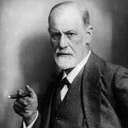 Freud photograph. He has a stern look on his face, a short, white beard, and a cigar in his hand.