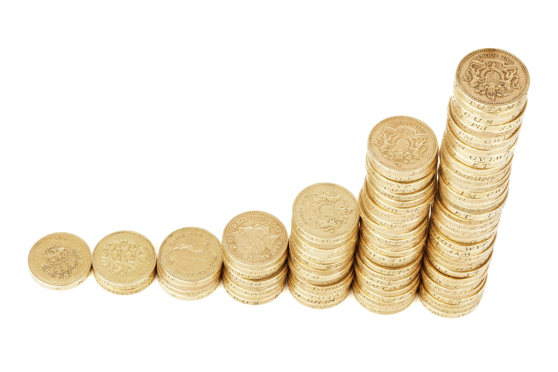Stack of gold coins, lined up like a bar graph with just a few on the left side and a large sum on the right.