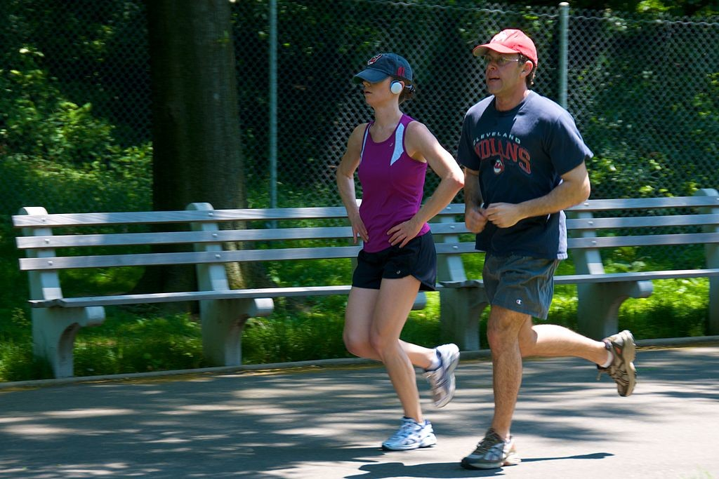 Man and woman in athletic clothes going for a jog.