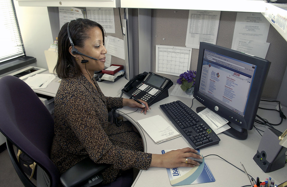 African-American businesswoman working on a computer.