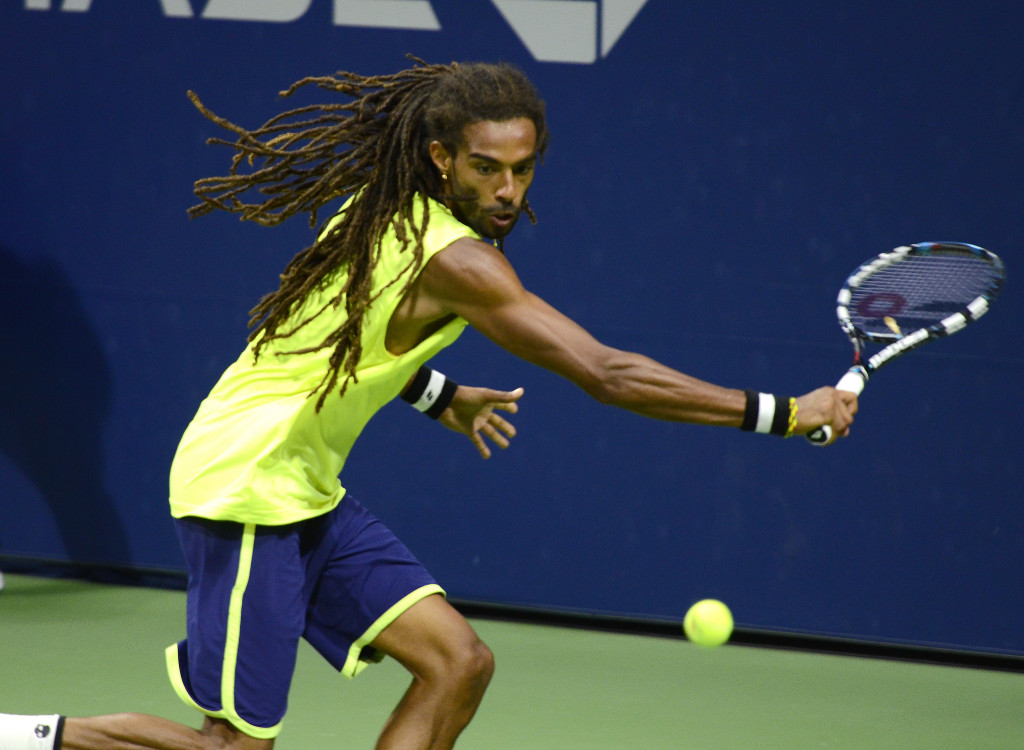 Action shot of Dennis Brown on the tennis court at the U.S. Open