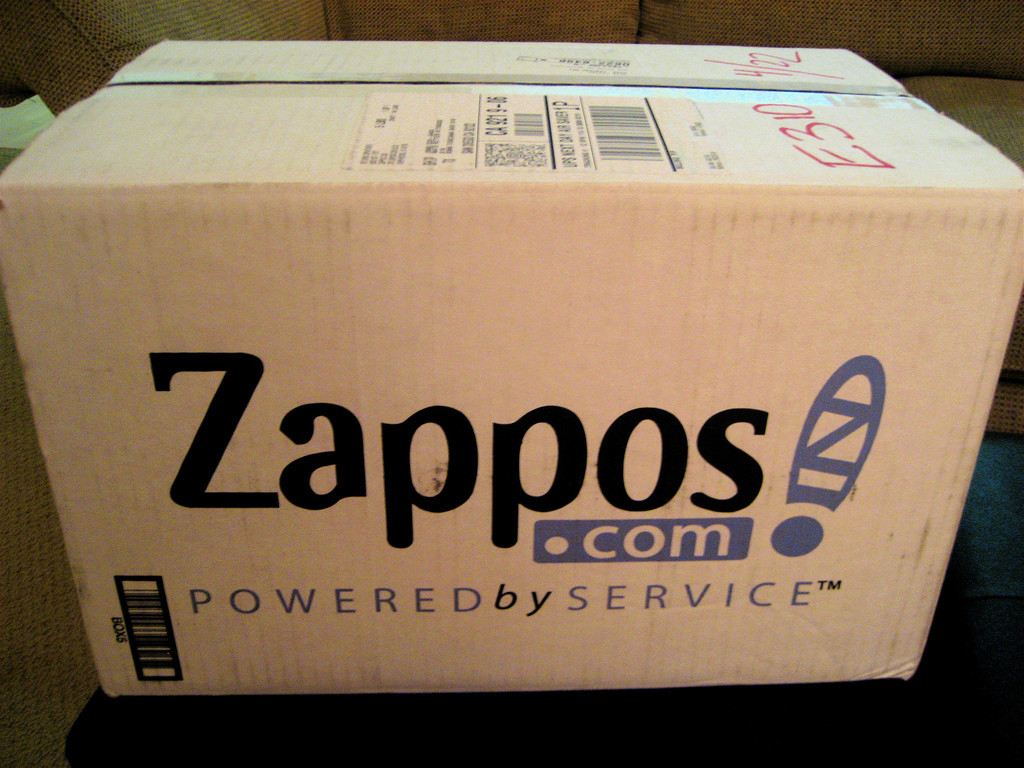"Photo of a Zappos.com shipping box with its tag line ""Powered by Service."""