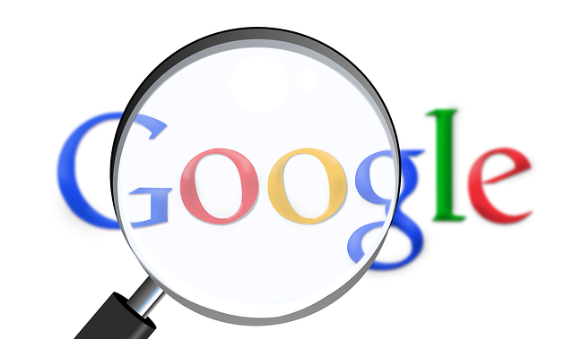 Google logo with a magnifying glass superimposed.
