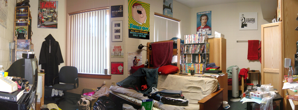 A room full of pop-culture-themed posters, books, and movies.