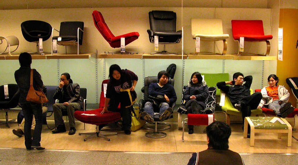 People sitting on a great variety of lounge chairs.