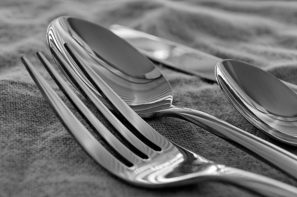 Photo of a fork, knife, and two spoons.