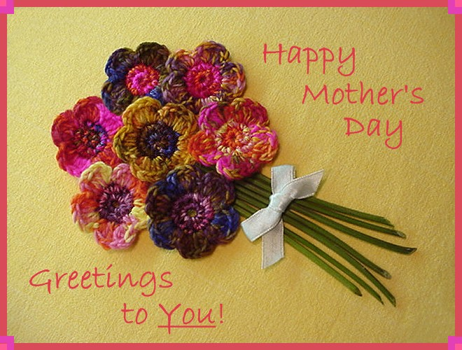 "Greeting card that reads, ""Happy Mother's Day Greetings to You!"" Card has a bouquet of pink and purple crocheted flowers in the center."
