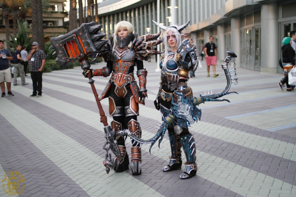 Two female Blizzcon attendees pose outside the venue. Both are dressed in elaborate videogame character costumes.
