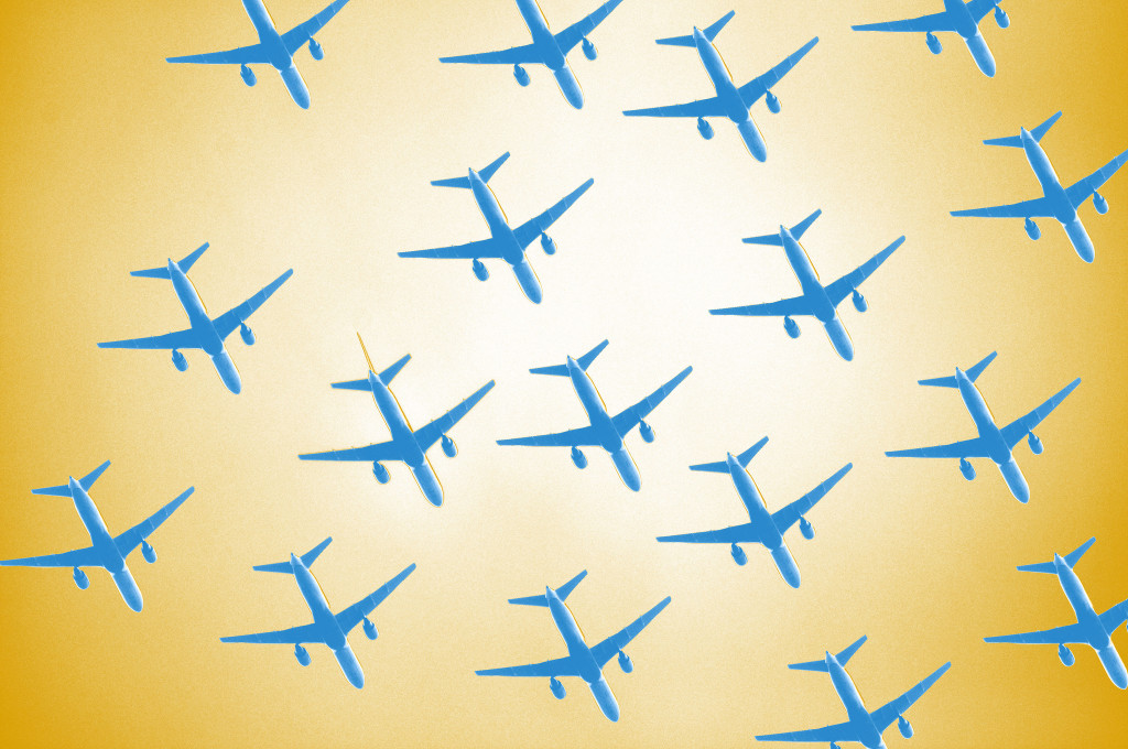Drawing of twelve blue airplanes against a yellow background. Planes are seen from below.
