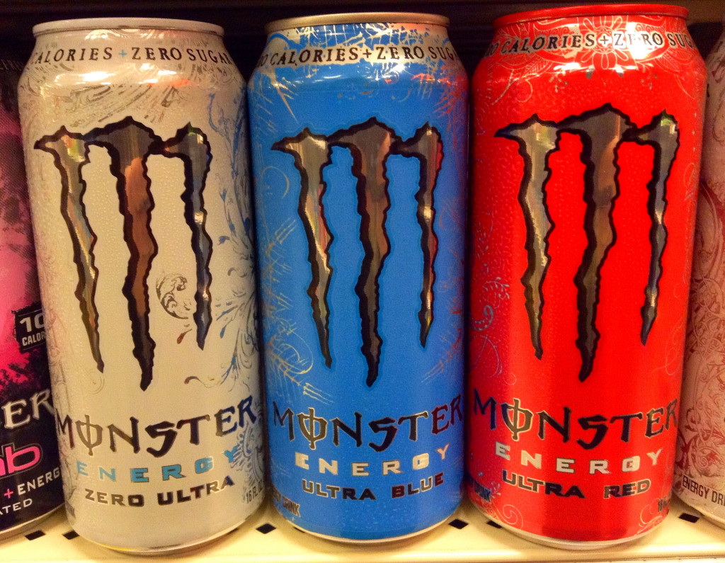 Cans of Monster Energy Drink in different colors.