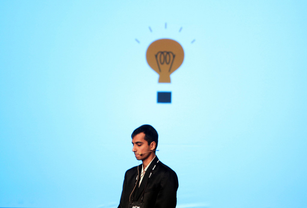 A man beneath a cartoon light bulb.