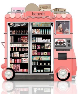 Benefit vending machine. It is pink and shaped like an ice cream truck. Inside is a wide selection of makeup and beauty products.