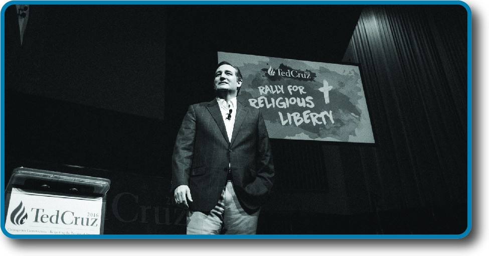 An image of Ted Cruz standing in front of a sign that reads