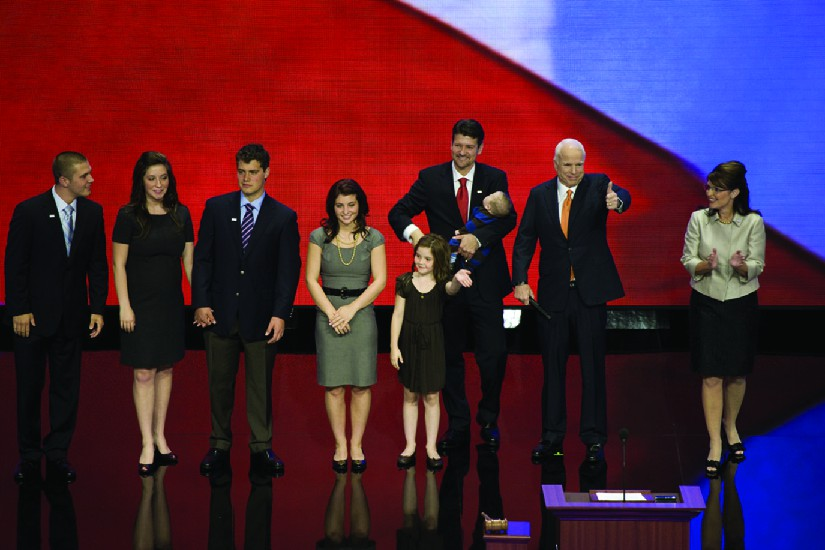 An image of Sarah Palin on a stage with John McCain and several other people.