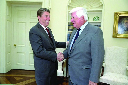 An image of Ronald Reagan shaking hands with Tip O'Neil.