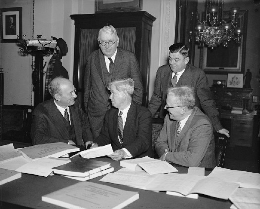 A photo of Henry Morgenthau, Jr., Daniel Bell, and three members of the House Appropriations Committee.