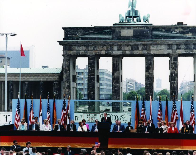 A photo of Ronald Reagan giving a speech in Berlin.