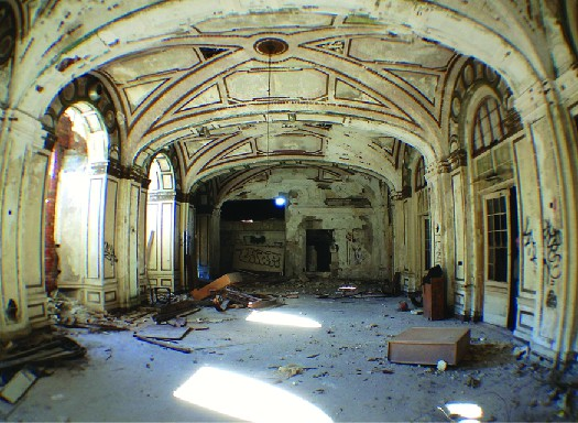 An image of the inside of a dilapidated building.