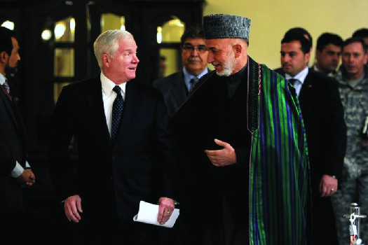 An image of Robert Gates speaking with Hamid Karzai.