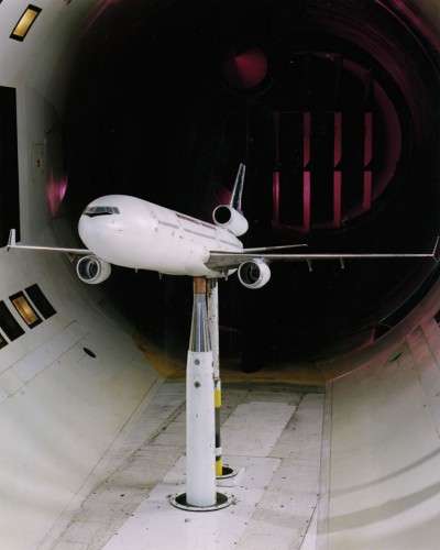 A model plane is can be seen being tested in a wind tunnel.