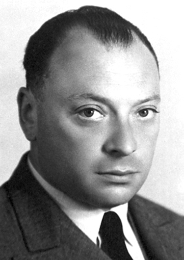 A black and white portrait of Austrian physicist Wolfgang Pauli.