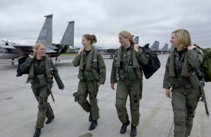 Female pilots walking toward their planes.