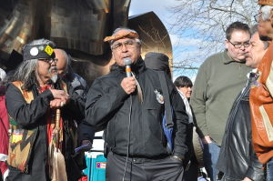 Speakers platform at raising of John T. Williams Memorial Totem Pole