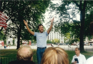 A man addressing a crowd.