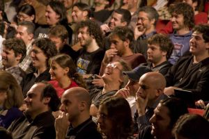 Audience laughing.