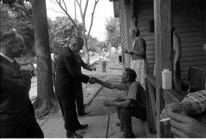 President Johnson shaking hands.