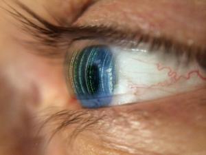 Eye looking at computer code