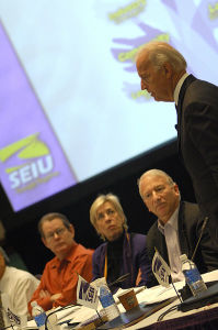 Joe Biden being questioned by a panel of people.