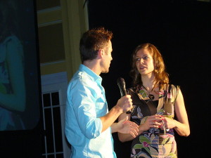 Man interviewing a woman on a stage