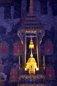 Golden Buddha statue in a Tibetan shrine